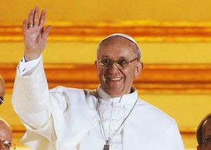 Newly-elected Pope Francis smiles shyly and waves to the crowd.